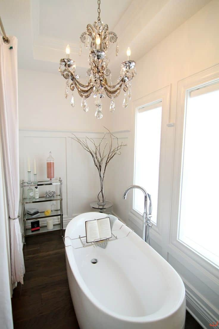 Bathroom decor ideas - add a chandelier for lighting for an elevated look.