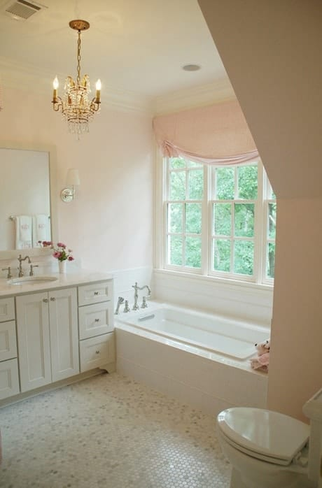 elevate your bathroom by adding a chandelier - cottage inspired decor