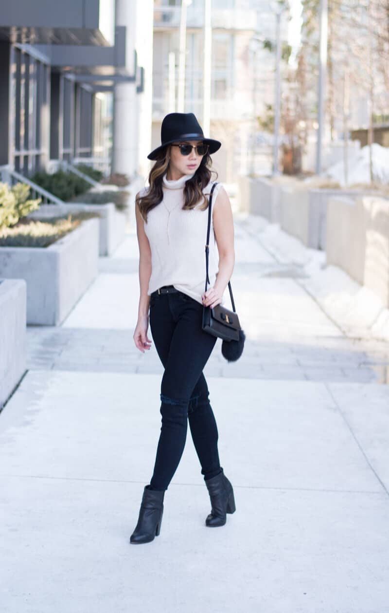 One of my fave daily looks, ripped jeans paired with a cute sleeveless sweater. Rag and Bone jeans and hat, Aritzia sweater, Ferragamo Bag