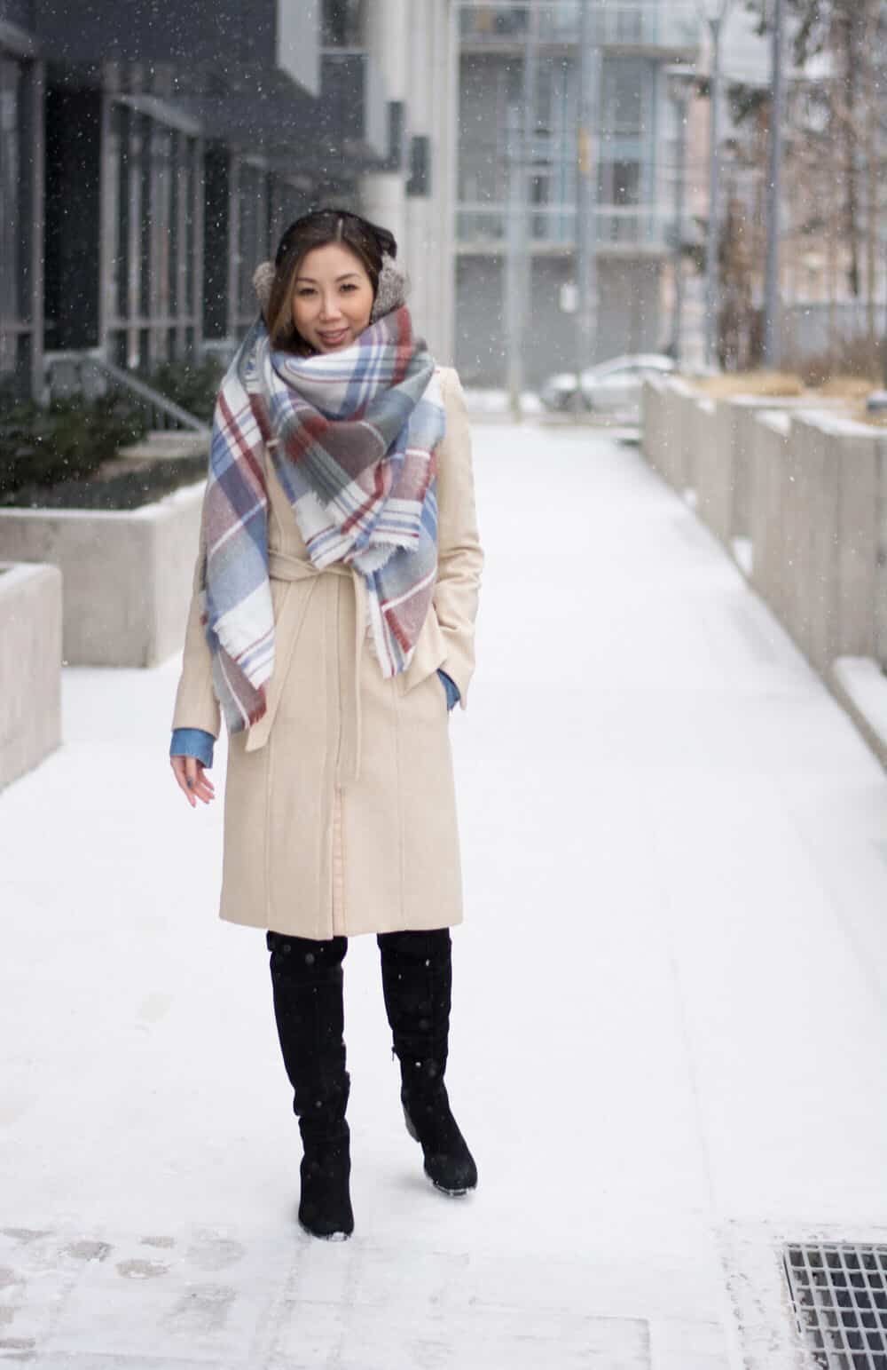 Cosy Winter OOTD streetstyle look: plaid scarf and long wool coat, fur ear muffs