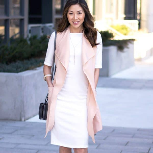 Spring look with white dress and pink vest.