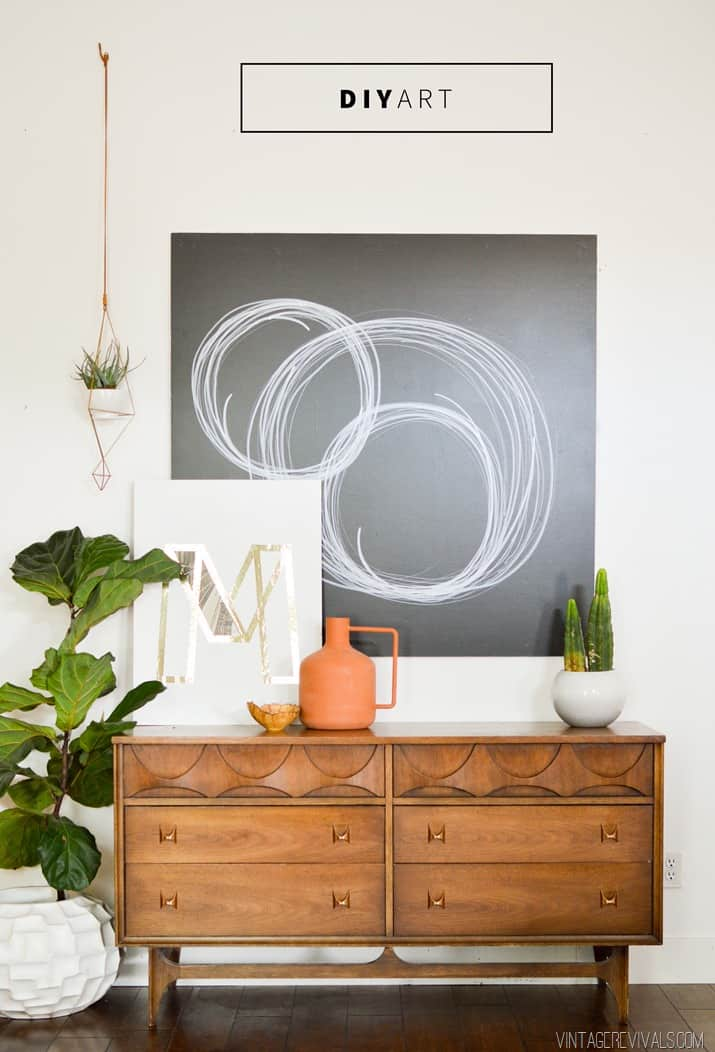 DIY black and white art work. This piece of modern looking art is done with sharpies, a piece of wood and paint!