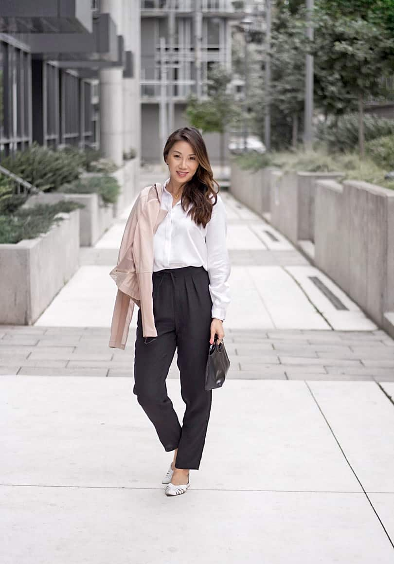 Toronto Streetstyle: minimalist style with silk blouse and pants and pink moto jacket