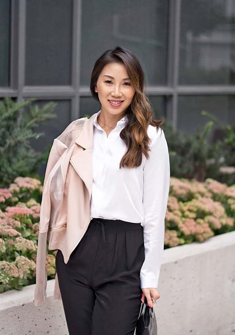 Staying classy! Toronto fashion blogger YesMissy wearing pink moto jacket with silk trousers and shirt