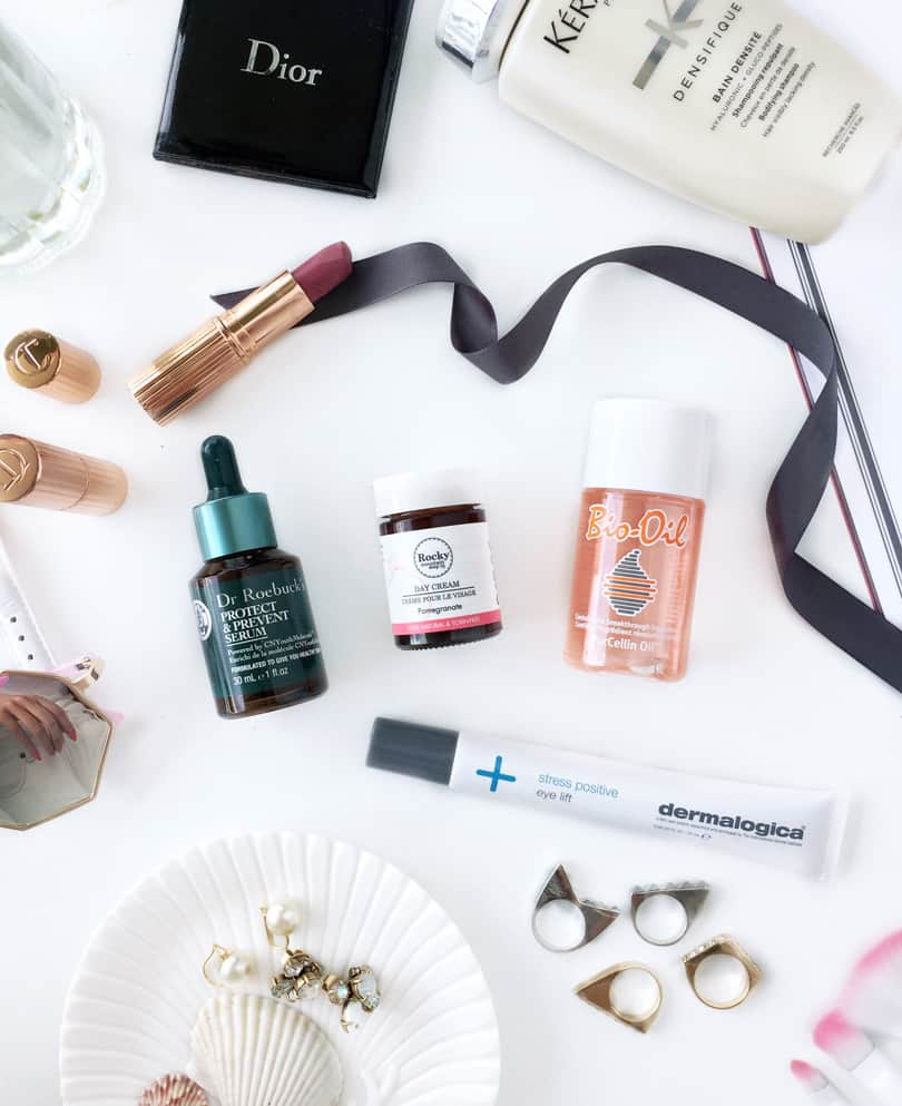 Makeup flatlay for my favorite skincare products this month! Beauty reviews for Dr. Roebucks, Biooil, Dermalogica and Rocky Mountain Soap Co.