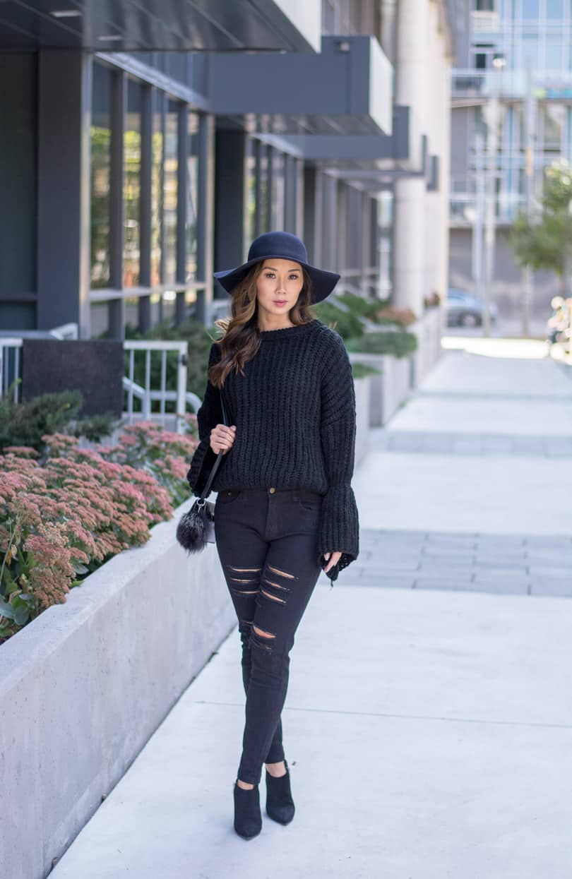 The fashion forecast for this year shows statement bell sleeves as a hot trend for the fall and winter seasons. Fashion blogger look: bell sleeves and ripped jeans