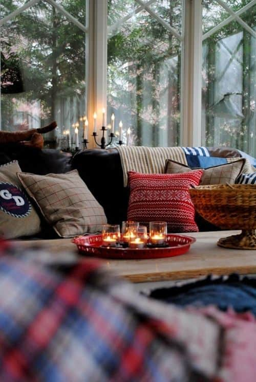 Candles are one way to warm the room and complement the crisp winter air outside. Try lighting a spicy candle, with something like a cinnamon and apple fragrance
