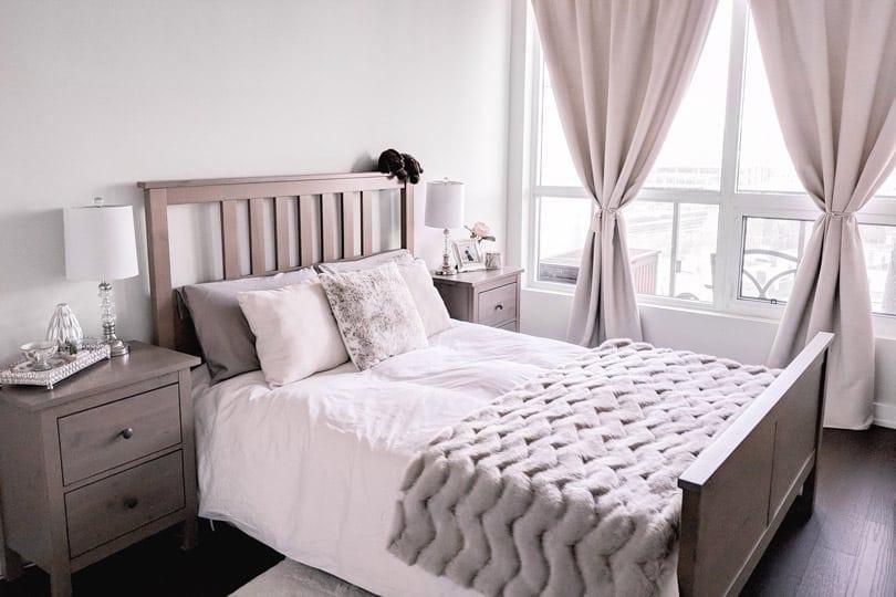 Cozy bedroom make over in neutrals. Love the fur throw!