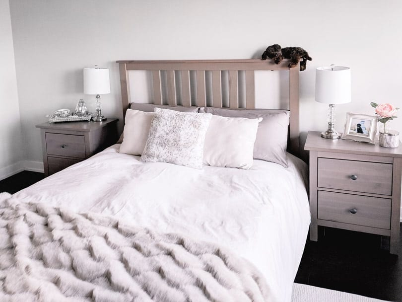 Cozy bedroom design with bedding from Skylark and Owl linen, pillows and fur throw