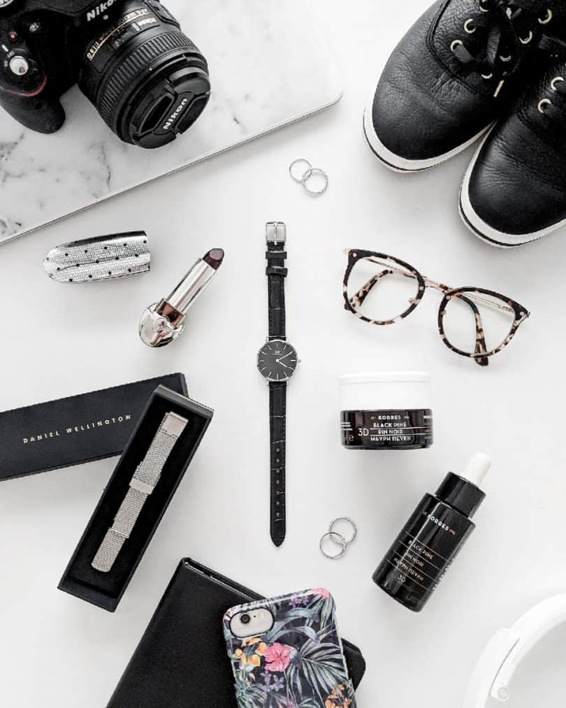 Monochrome Flatlay: featuring Daniel Wellington watch, Korres skincare, Ideal of Sweden phone case, Ked's Shoes, Guerlain Lipstick, Bon Look glasses ...more at yesmissy.com