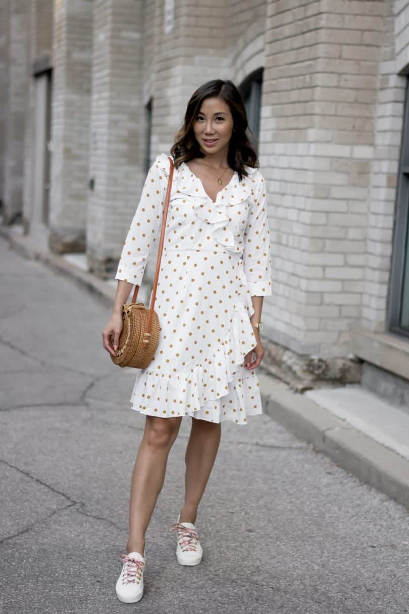 Toronto Style: polka dot dress, white sneakers, round rattan bag