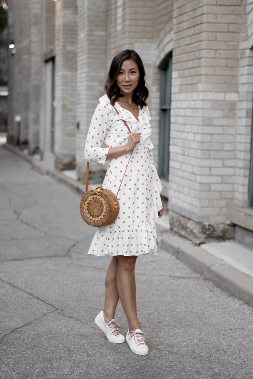 Blogger style: white summer dress and Keds sneakers, round basket bag