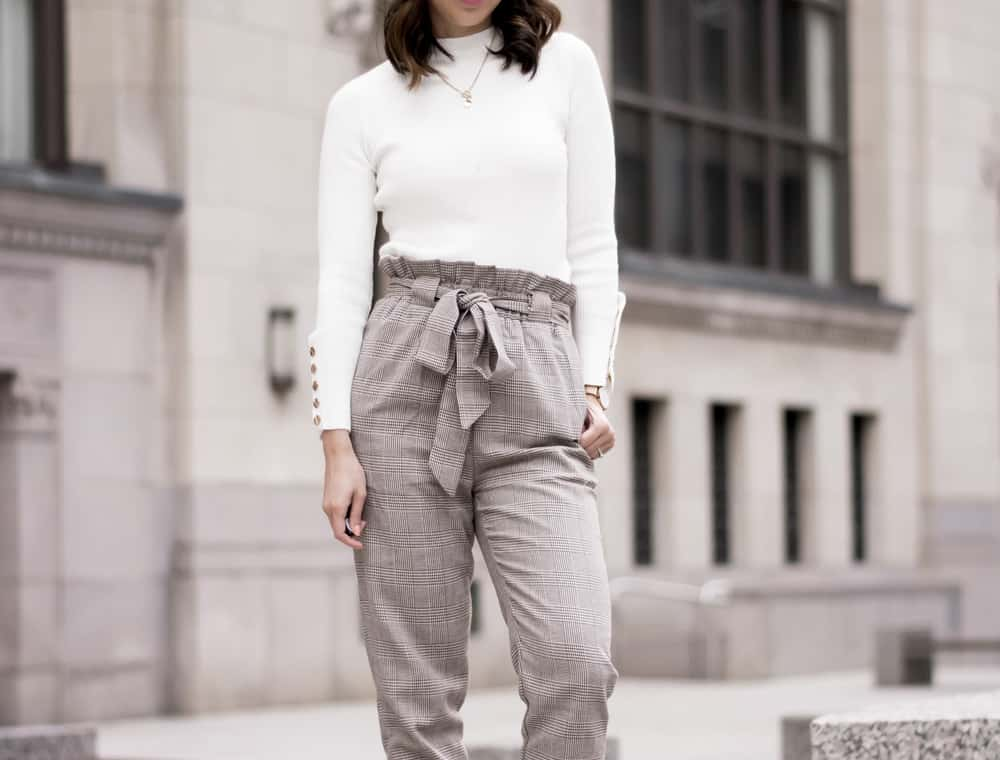 Tied up checkered pants and cream sweater