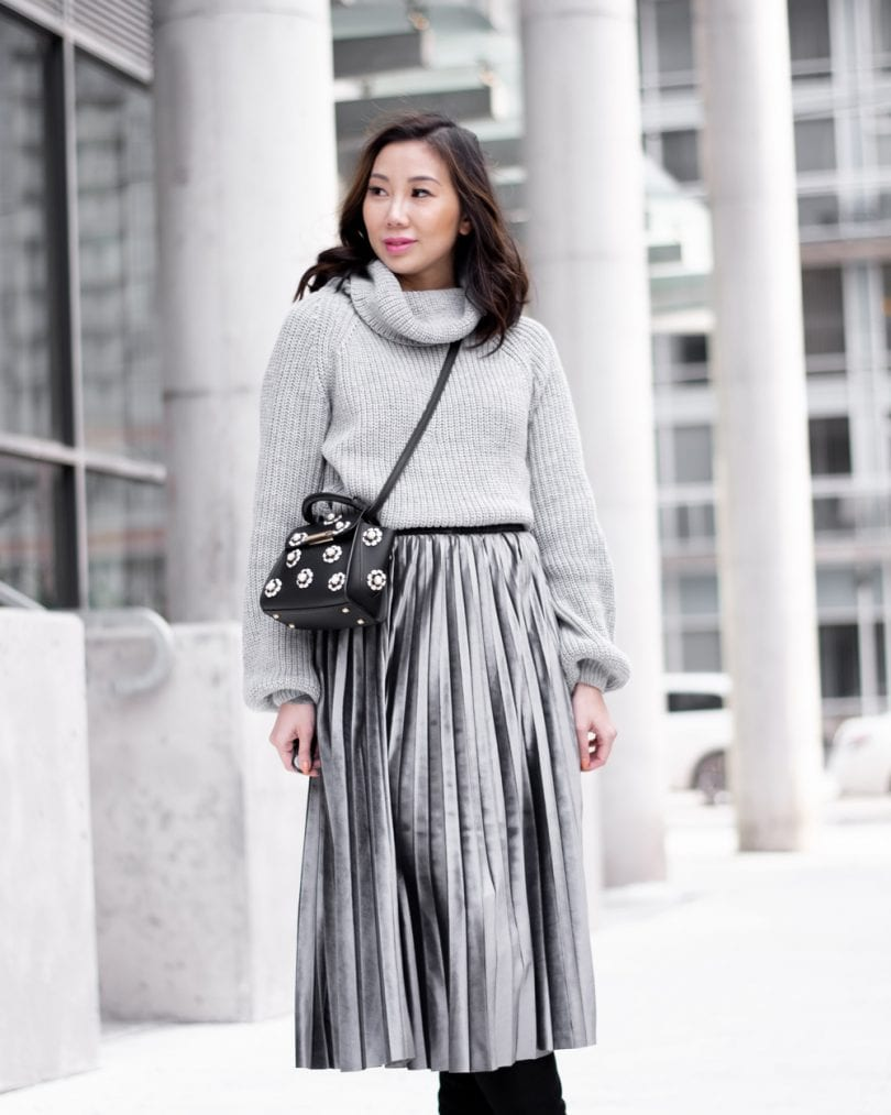 Outfit ideas to get out of a style rut - grey pleated skirt, grey sweater, mini bag