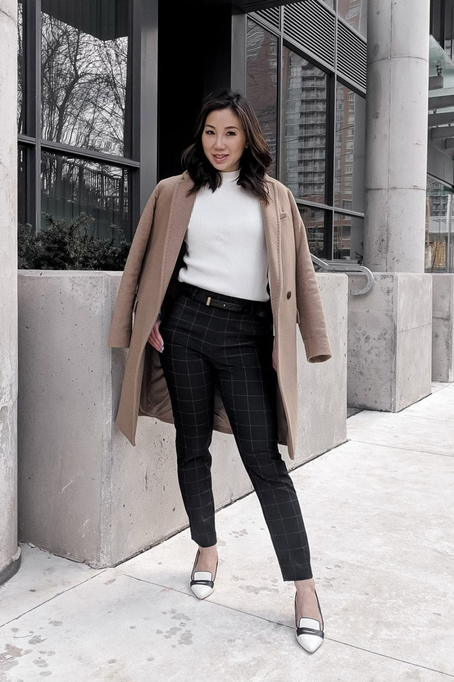 Workwear OOTD - camel coat, checkered pants, white sweater, contrast pumps