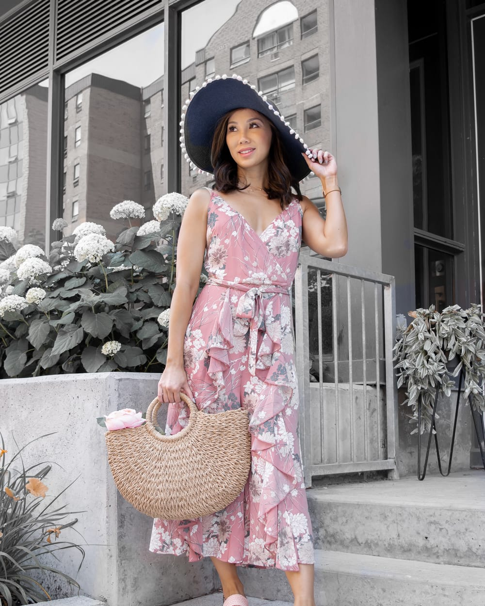 Summer outfits ideas for a weekend getaway - floral jumpsuit, basket back, floppy hat