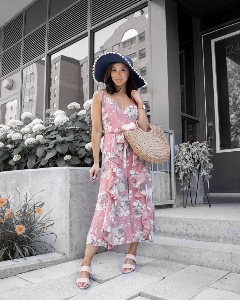 Summer outfit ideas - Pink ruffle jumpsuit, woven sandals, and basket bag
