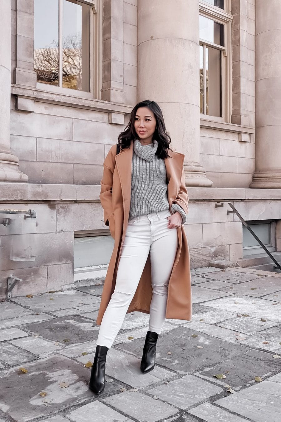 Winter outfit ideas - long camel coat, sweater and white jeans