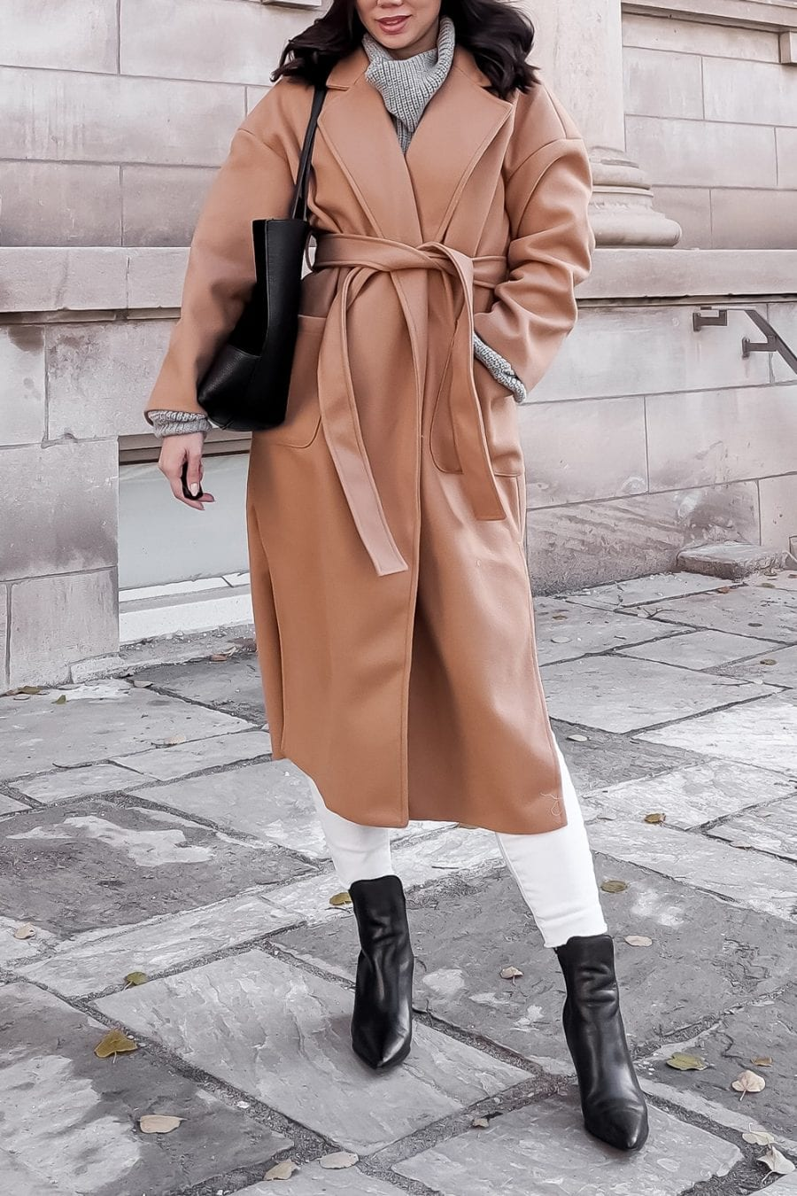 Winter coat details - long camel wool coat with white jeans and ankle booties
