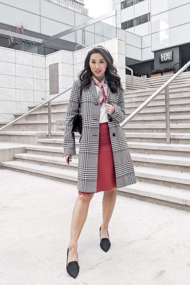 Eileen Lazazzera of YesMissy styles a plaid coat, red sweater skirt and blouse from Ann Taylor for a Valentine's Day Look