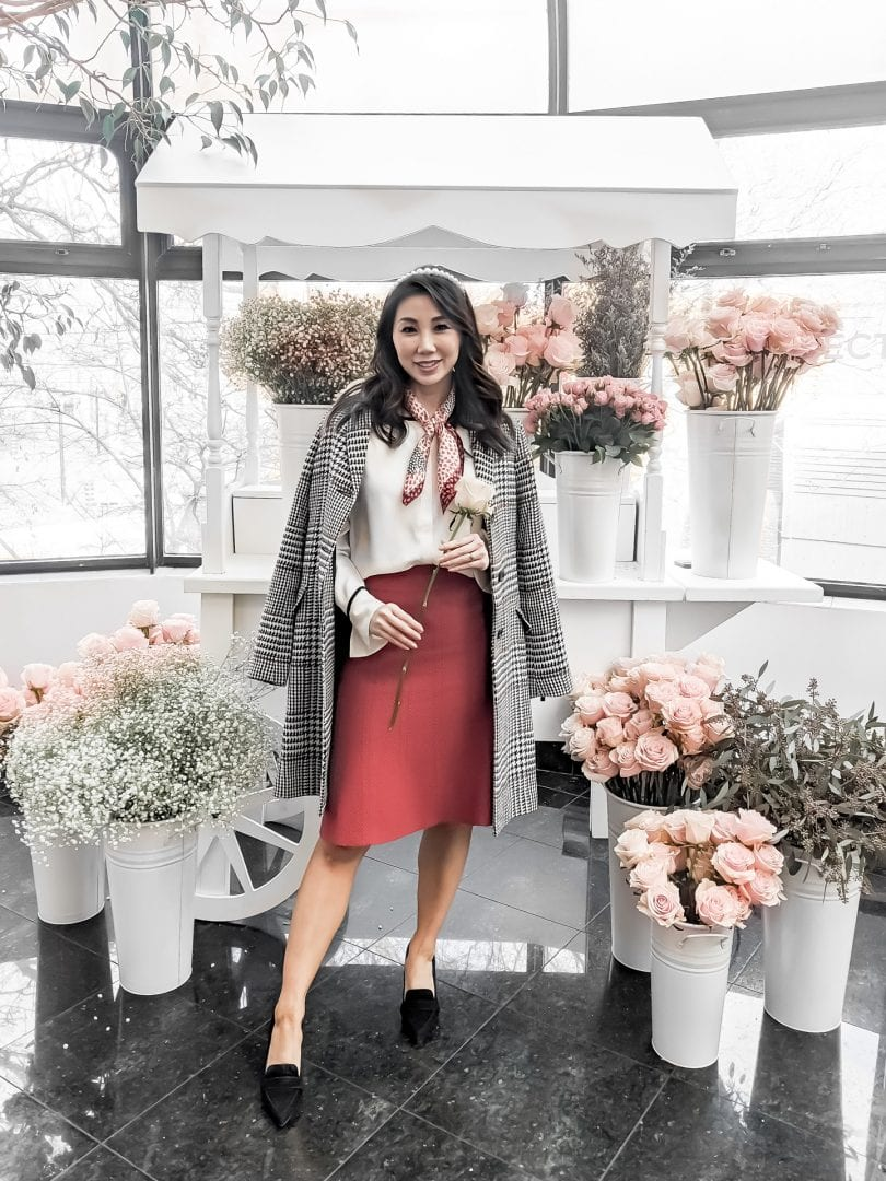 LIfestyle Blogger YesMissy styled a Valentine's Day Outfit in partnership with Ann Taylor wearing a plaid coat, red sweater skirt, white blouse and suede loafer pumps