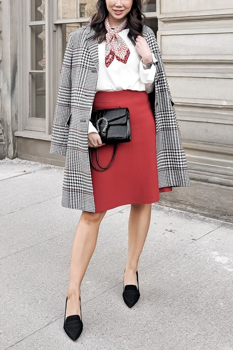 Detailed look at workwear OOTD with plaid coat, red skirt and loafer pumps from Ann Taylor
