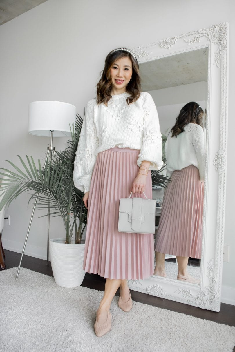 Cozy casual outfit with pink pleated midi skirt and white pompom sweater - spring outfit ideas