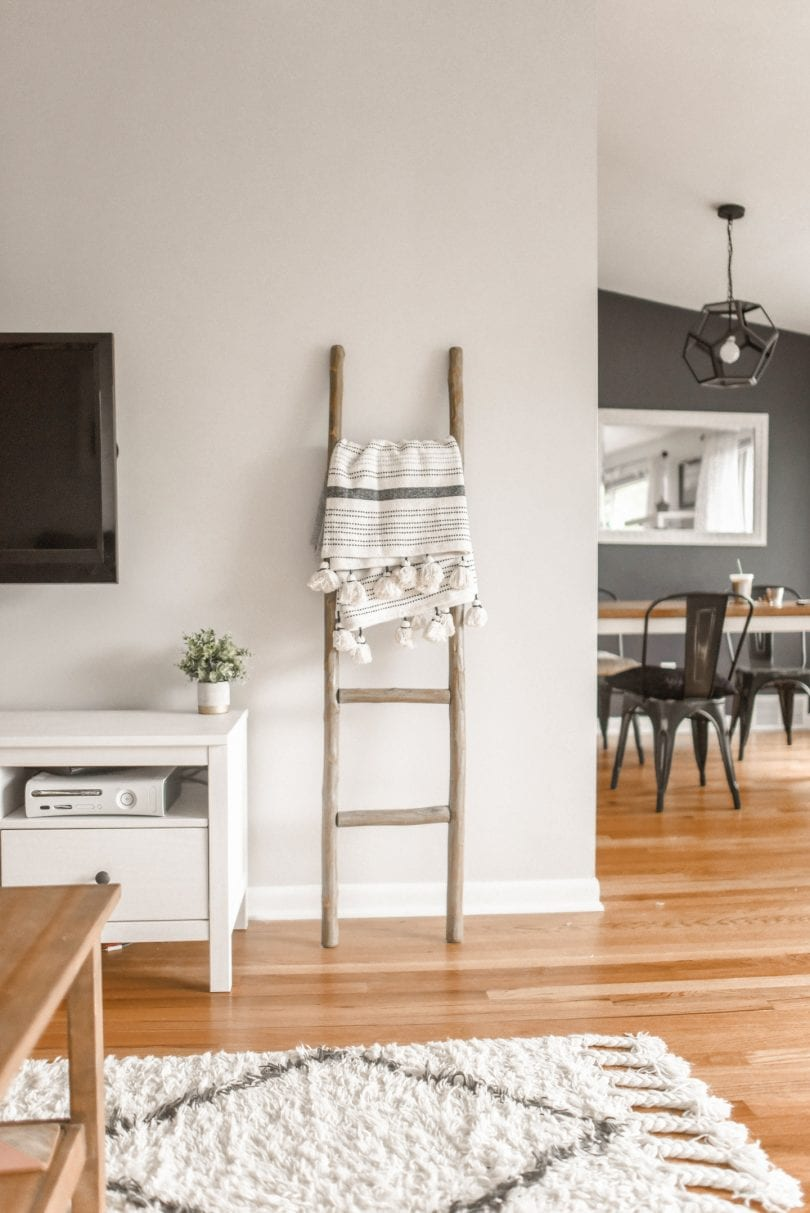 10 storage ideas for small homes - use standing ladders to hang up blankets.. read more at yesmissy.com