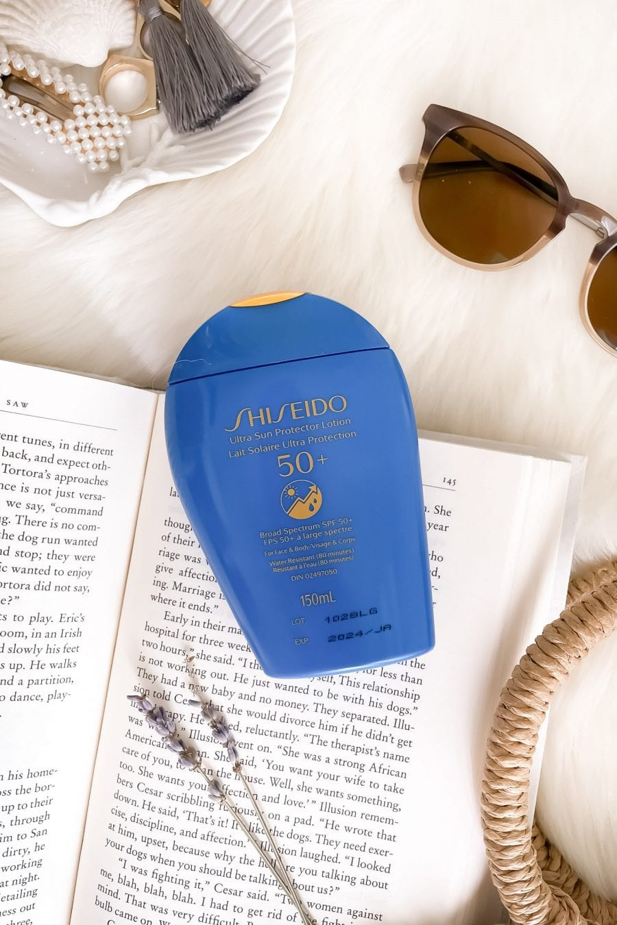 You don't need to have dark skin to love this sunscreen. The Shiseido Ultra Sun Protection Lotion SPF 50 is for both face and body. It's the sheerest sunscreen I've ever tried and leaves not white cast. It feels like nothing on works well under makeup. More on yesmissy.com