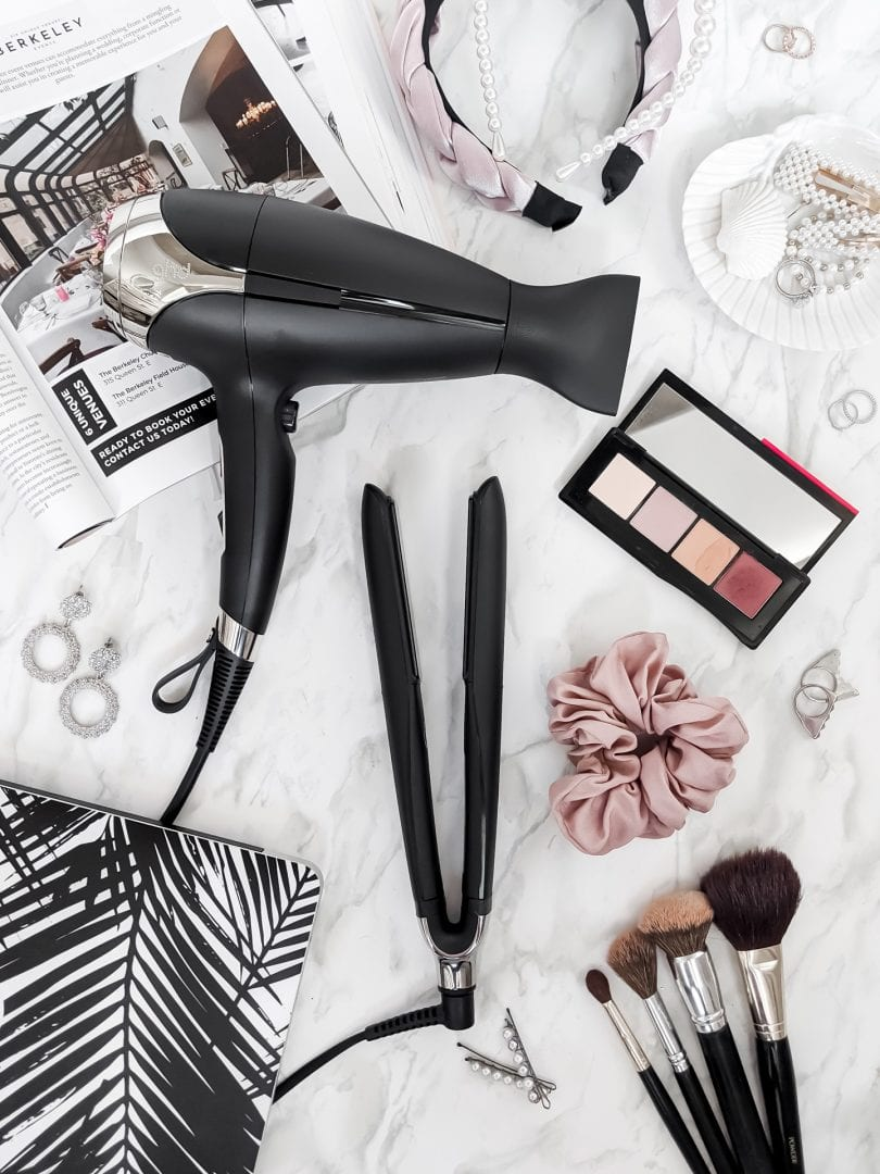 GHD hair tools: Platinum+ Styler and Flat Iron, and Helios Professional hair dryer. Tools for creating lasting hair styles.