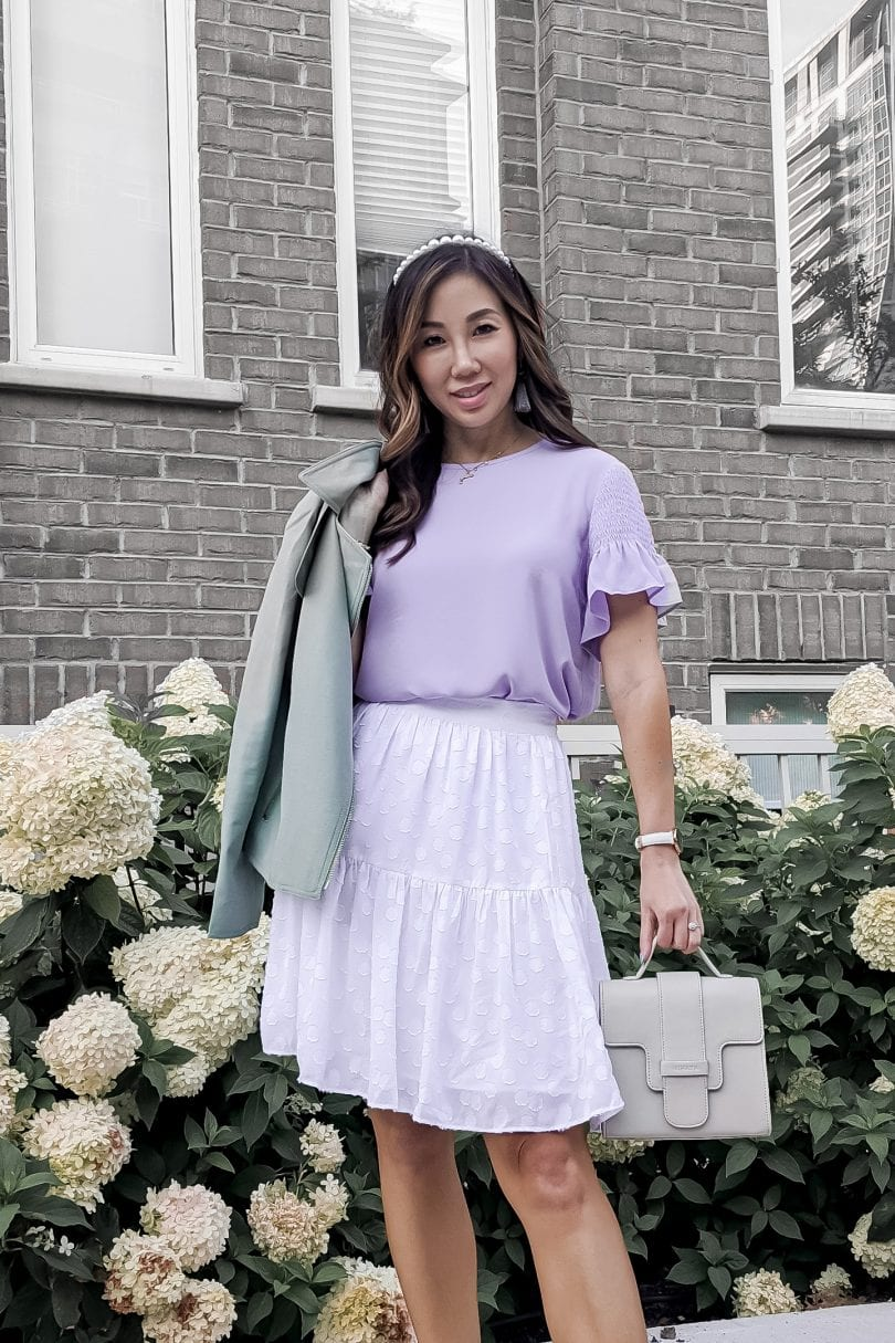 Millenial purple trend: Lavendar blouse and white skirt paired with a mint moto jacket from Ann Taylor styled by Eileen Lazazzera of YeMissy Lifestyle Blog