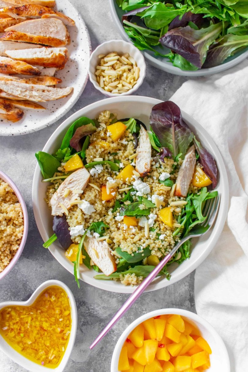 This Peach Quinoa Salad is the perfect cold lunch meal prep as well as being super easy to make for a large gathering! Look no further for a cold lunch idea than this sweet peachy salad.