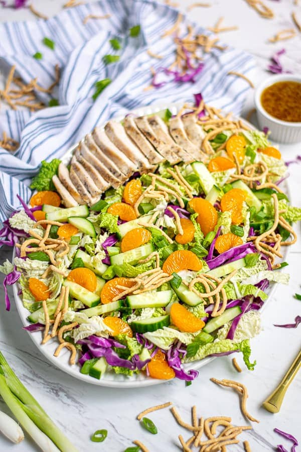 Asian coleslaw salad on a white table with sesame dressing
