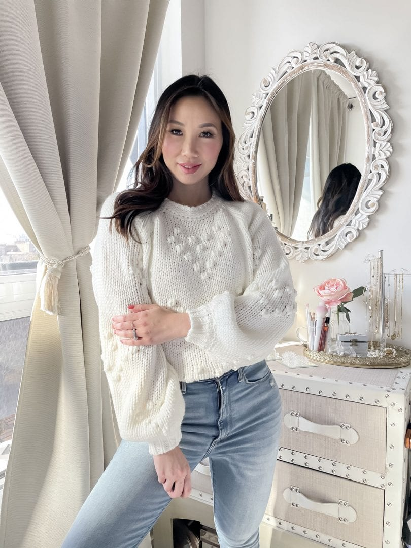 Best sweaters under $40 - pompom heart knit sweater worn with denim styled by Eileen Lazazzera of yesmissy.com