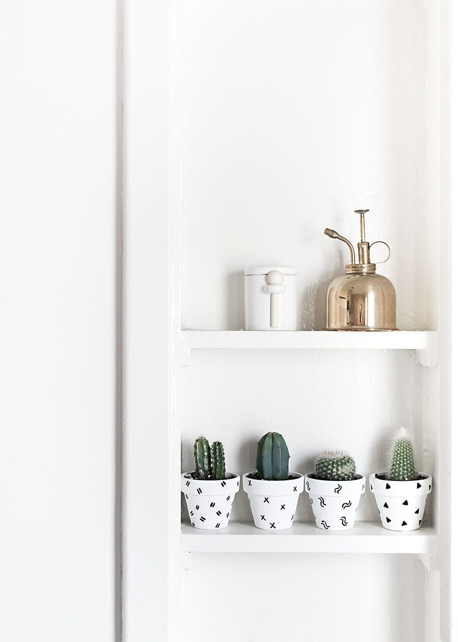 DIY Sharpie home decor ideas - Give your plain terracotta pots a makeover with a little paint and some sharpie marker designs.