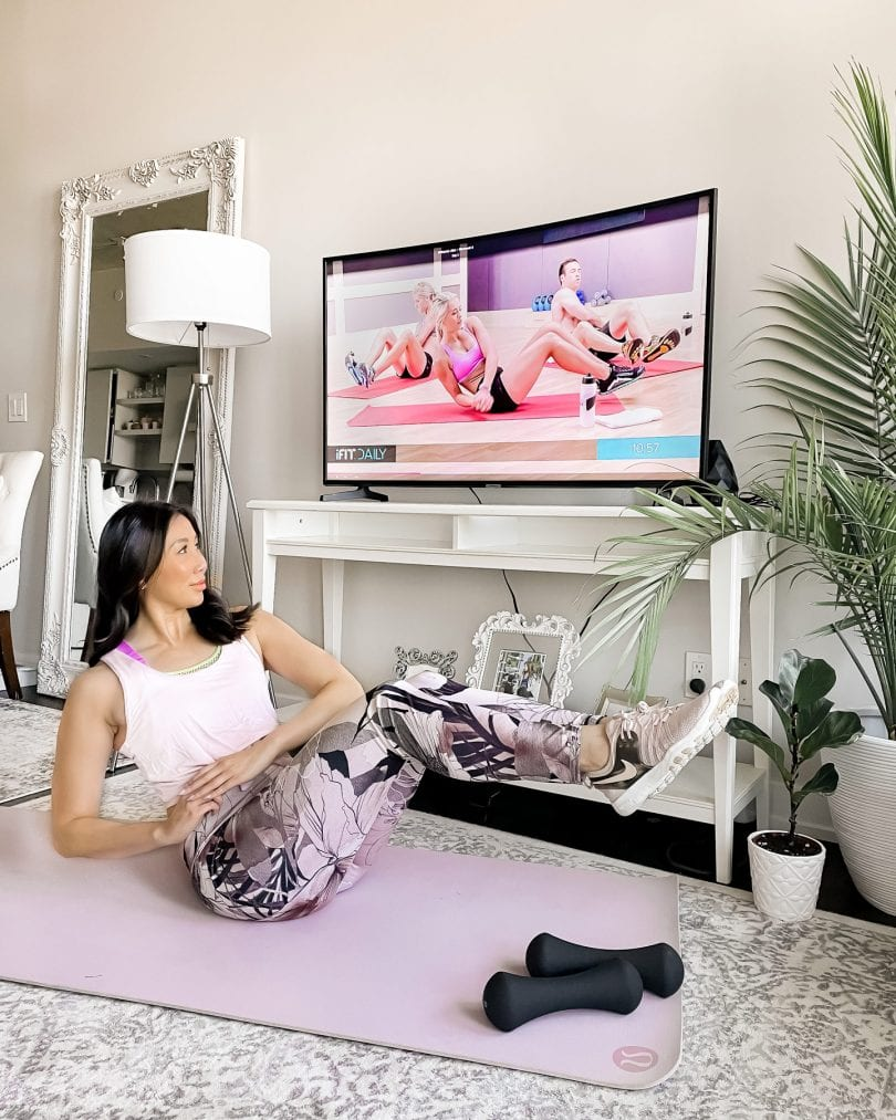 Working out at home in my living room with the iFit app. It has on both demand or live workouts that you can with or without equipment.