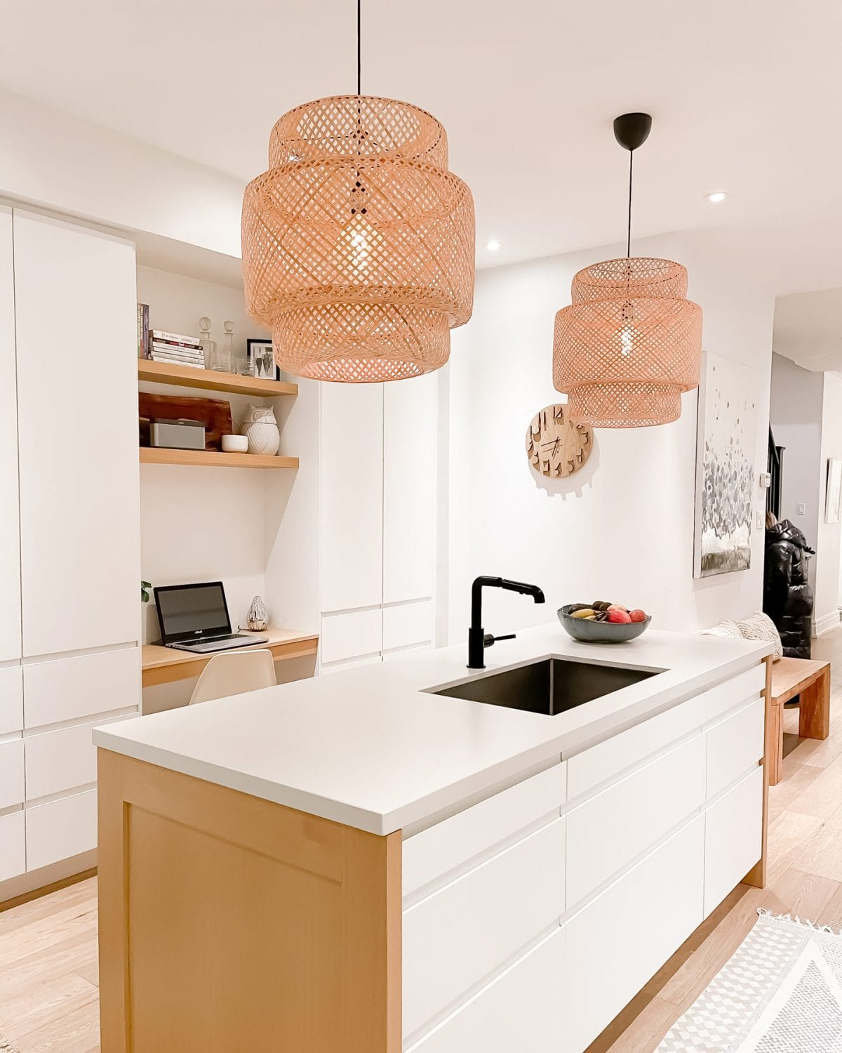 Kitchen desk area - white kitchen with wood accents and basket pendant lights.