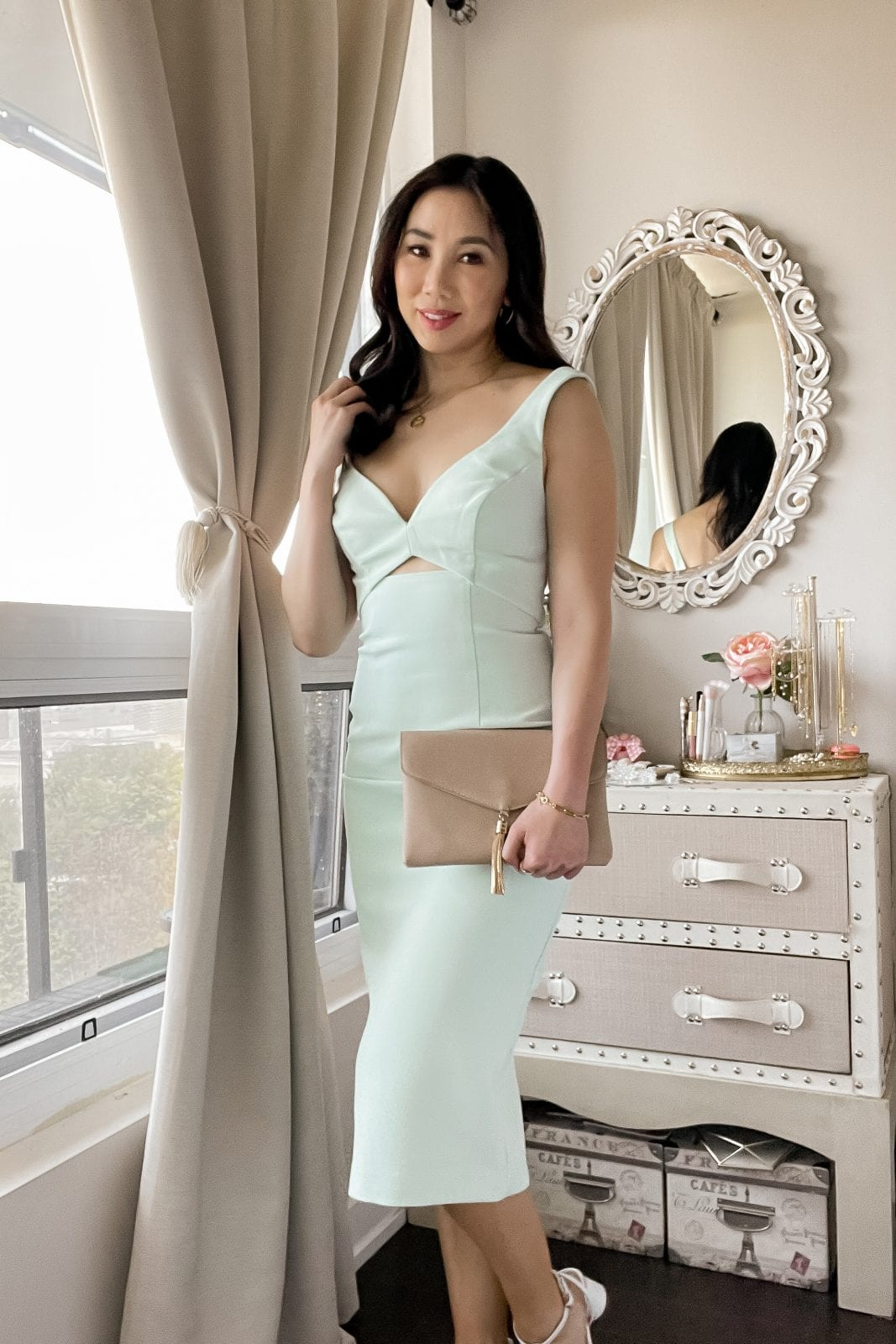 This sleek cut-out midi dress is the perfect wedding guest dress for summer! Check out more outfit inspiration at yesmissy.com