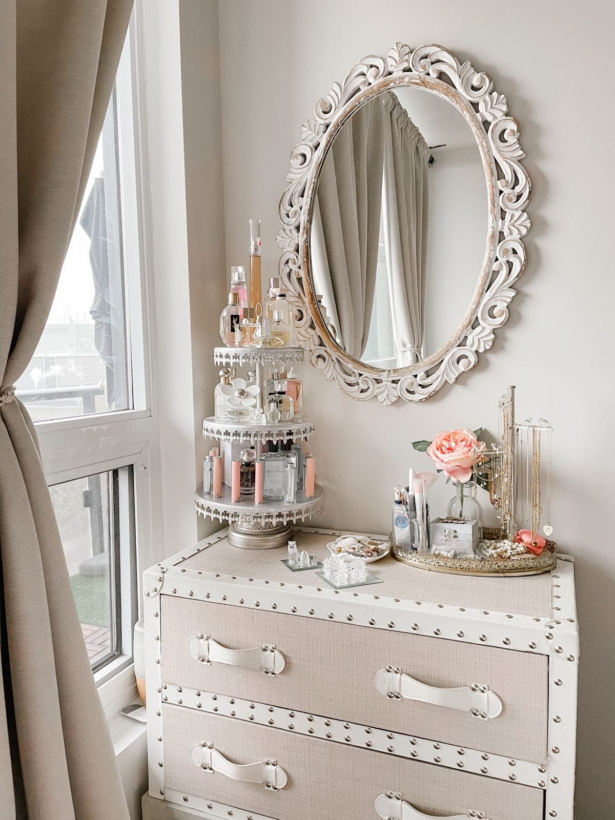 Bedroom vanity area with cake stand for perfume and makeup