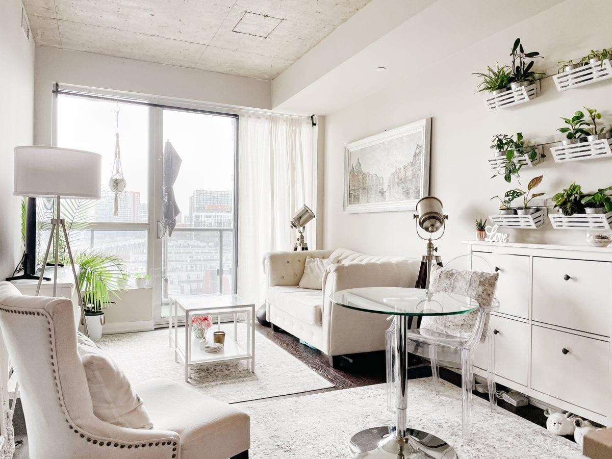 Condo tour - white boho chic condo living room with plant wall