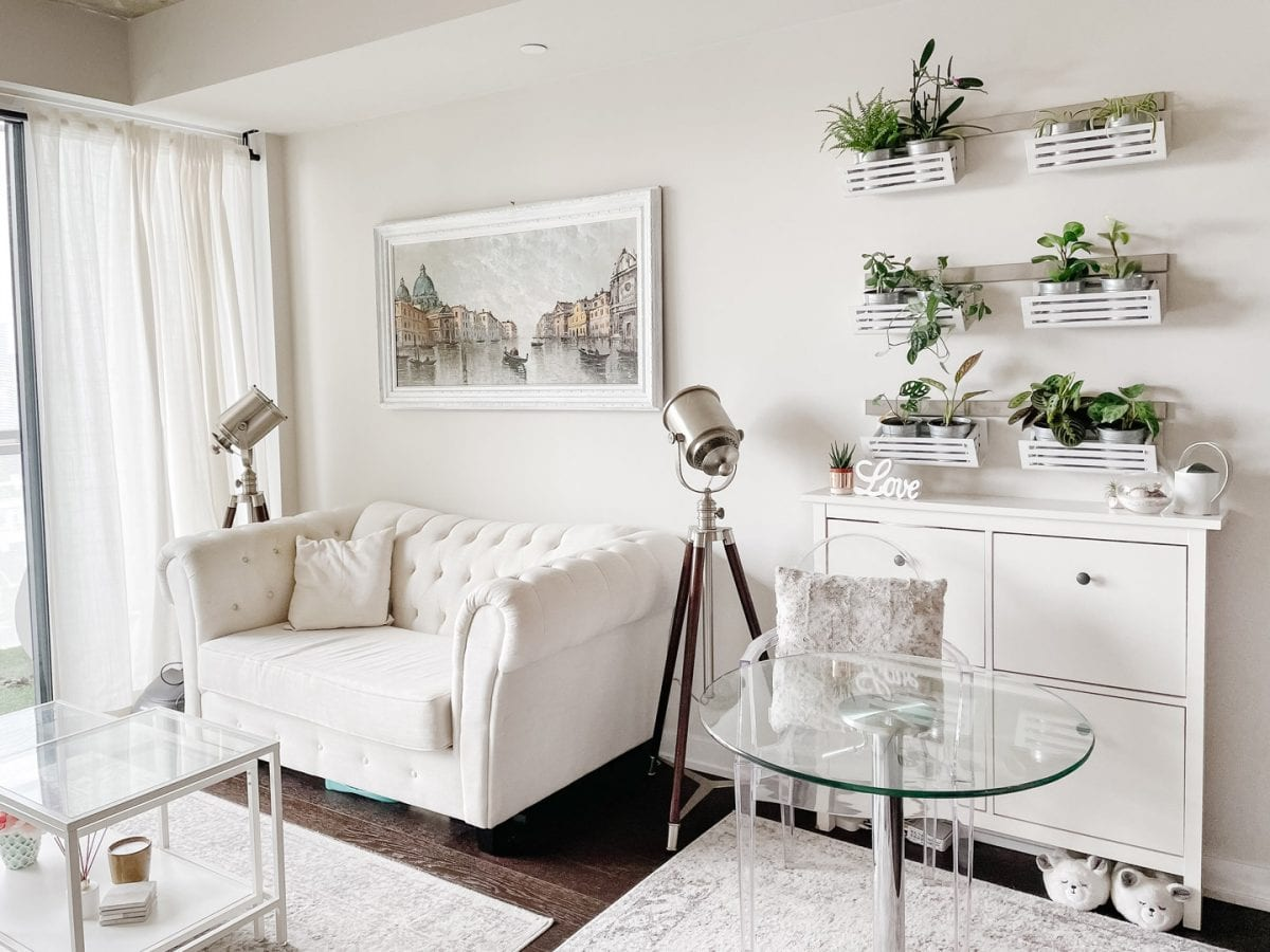 Condo living room - cottage chic style with sofa and plant wall in living room