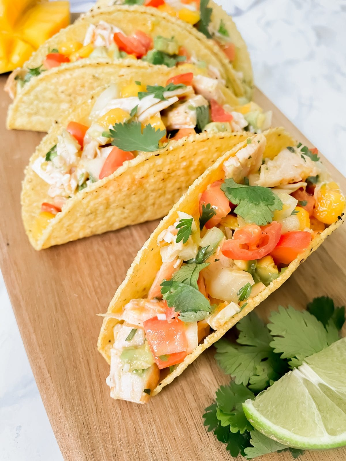 Easy recipe ideas - no cook turkey tacos with mango avocado salsa. Packed with healthy vegetables, fruit and lean protein. Get the full recipe on yesmissy.com