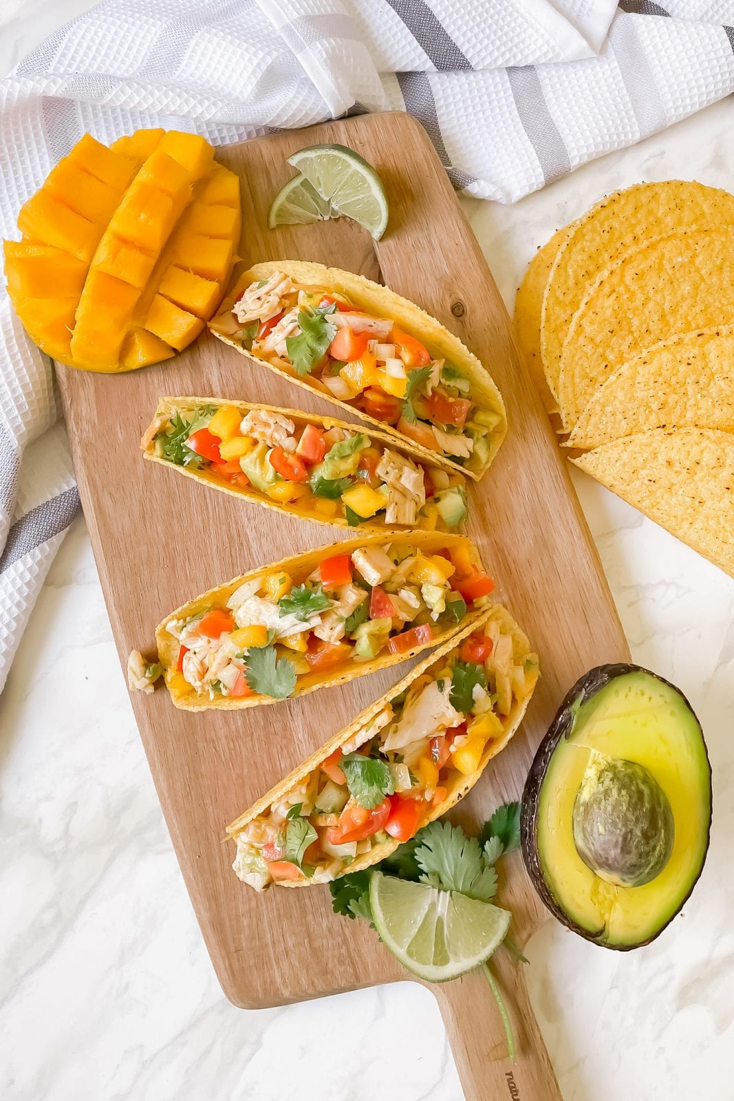 Make this turkey tacos recipe with mango avocado salsa in under 15 minutes. This easy, healthy and delicious recipe doesn't require any cooking and will be a hit with the family. Get the full recipe on yesmissy.com